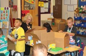 Karen McDivitt helps unpack donated school supplies